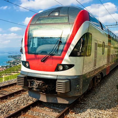 wine road: Train at Vineyard Terraces of Lavaux at Lake Geneva and Swiss Alps, Lavaux-Oron district, Switzerland