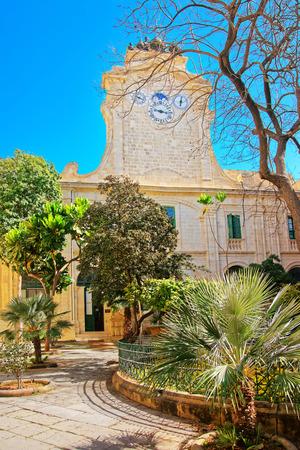 Clock tower at Prince Alfred Courtyard at Grandmaster palace, Valletta, Malta Stock Photo