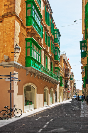 decorative balcony: Traditional green balconies in Valletta old city, Malta. People on the background