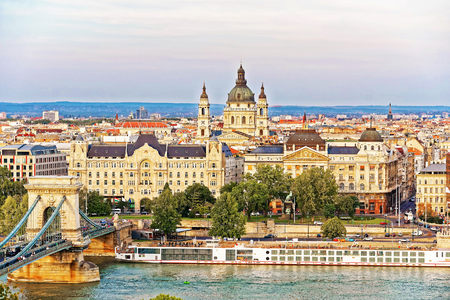 Chain Bridge over Danube River and St Stephen Basilica at Pest city center in Budapest, Hungary