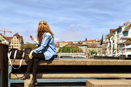 Girl relaxing at Limmatquai of Zurich, Switzerland Stock Photo