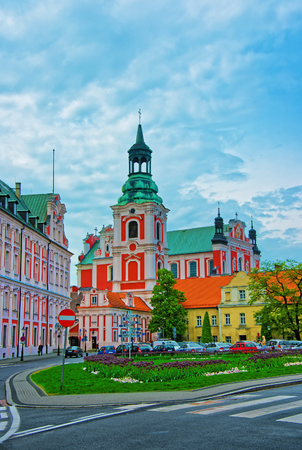 poznan: St Stanislaus Church at the Old town of Poznan, Poland. People on the background Stock Photo