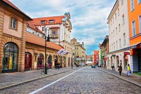 poznan: Poznan, Poland - May 7, 2014: Cobblestone Paderewski street at the Old Town of Poznan, Poland. People on the background. Editorial