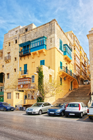 Street with staircase in the old city center of Valletta, Malta Stock Photo
