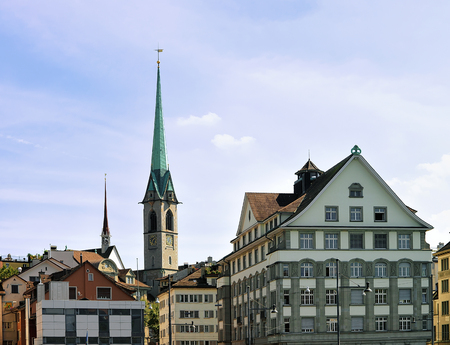 Spires of Grossmunster Church and Wasserkirche and rooftops of the city center in Zurich, Switzerland. Stock Photo