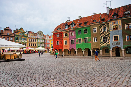 retailers: Poznan, Poland - May 7, 2014: Cafes and restaurants in Old Market Square in the city center in Poznan, Poland. People on the background