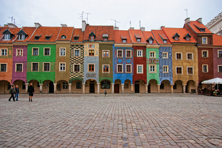 Poznan, Poland - May 7, 2014: Colorful buildings on Old Market Square in the city center in Poznan, Poland. People on the background