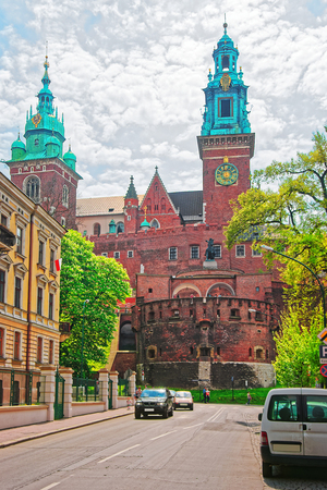 Krakow, Poland - May 1, 2014: Bell tower of Wawel Cathedral on the hill and people in Krakow city center, Poland.