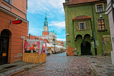 arcades: Poznan, Poland - May 7, 2014: Street view of Old Town Hall on Old Market Square in the city center of Poznan, Poland. People on the background Editorial