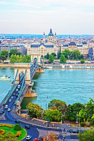 saint stephen cathedral: Chain Bridge above Danube River and Saint Stephen Basilica at Pest city center in Budapest, Hungary