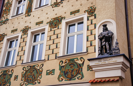 poznan: Poznan, Poland - May 7, 2014: Statue as a decoration on the building on Market Square in Poznan, Poland