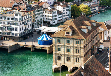 Old Town Hall and carousel at River Limmat in Zurich, Switzerland