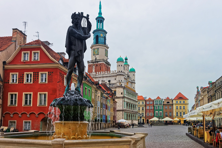 Poznan, Poland - May 6, 2014: Fountain of Apollo on the Old Market Square in the city center in Poznan, Poland. Old Town Hall and People on the background Editorial