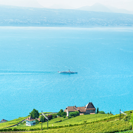 Railway line on Lavaux Vineyard Terraces hiking trail, Lake Geneva and Swiss mountains, Lavaux-Oron district, of Switzerland. Ship on the background Stock Photo