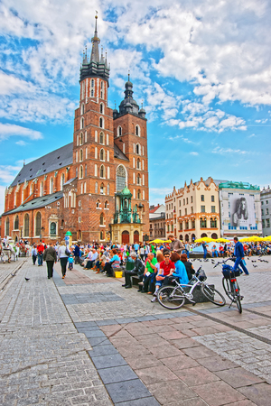 Krakow, Poland - May 1, 2014: St Mary Basilica on the Main Market Square, Krakow, Poland. People on the background