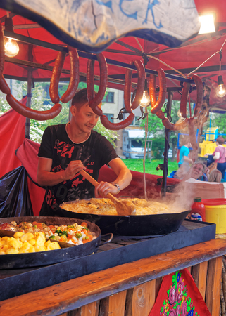 Krakow, Poland - May 1, 2014: Counter with seller cooking and trading traditional Polish food in the old town of Krakow, Poland Editorial