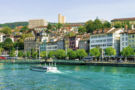 Ferry at Limmat River Quay in Zurich, Switzerland. People on the background