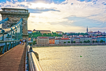 Budapest, Hungary - August 31, 2012: Chain Bridge and Buda city center at Danube Embankment in Budapest, Hungary. People on the bridge