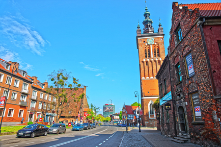 Gdansk, Poland - May 8, 2014: St Catherine Church in the city center of Gdansk, Poland. People on the background