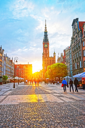 Gdansk, Poland - May 7, 2014: Main Old City Hall and Dlugi Targ Square in the old town of Gdansk at sunset, Poland. People on the background.