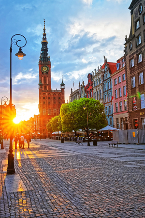 Gdansk, Poland - May 7, 2014: Main City Hall and Dlugi Targ Square in the old city center, of Gdansk at sunset, Poland. People on the background. Publikacyjne
