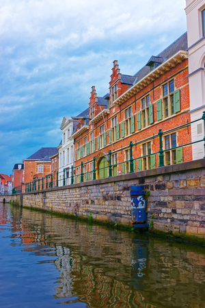 Guildhalls on Graslei and Korenlei over Lys River in Ghent in East Flanders, Belgium. Stock Photo