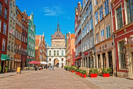Gdansk, Poland - May 8, 2014: Golden gate and Prison Tower at Dluga Street in the old city center in Gdansk, Poland. People on he background