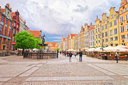 Gdansk, Poland - May 7, 2014: Neptune fountain at Dlugi Targ Square in the old city center of Gdansk, Poland. People on the background.