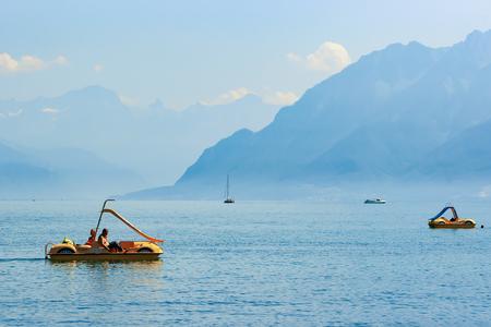 Lausanne, Switzerland - August 26, 2016: People in catamarans at Geneva Lake in Lausanne, Switzerland