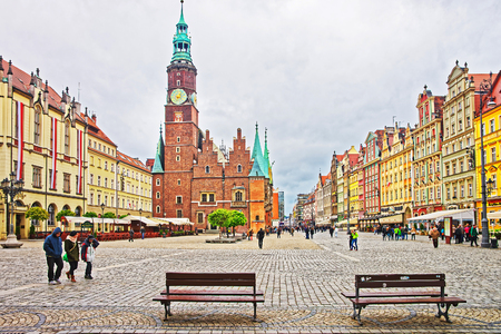 Wroclaw, Poland - May 3, 2014: Benches at Old Town Hall in the Market Square in Wroclaw, Poland. People on the background Editorial