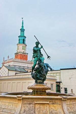 wielkopolska: Poznan, Poland - May 6, 2014: Neptune fountain in Old Market Square in the city center in Poznan, Poland.