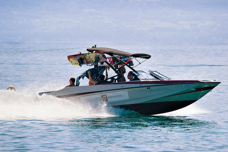 Lausanne, Switzerland - August 26, 2016: People in motorboat on Lake Geneva in Lausanne, Switzerland
