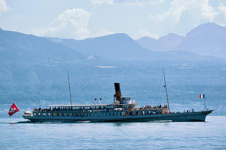 Ferry cruise on Lake Geneva in Lausanne, Switzerland. People on the background Stock Photo