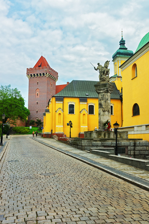 regiment: Poznan, Poland - May 7, 2014: Uhlans Regiment Monument and Royal Castle of Poznan and people on background, Poland. Editorial
