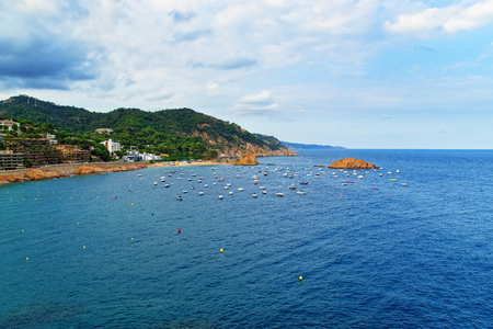 Boats in the bay at Tossa de Mar of the Costa Brava at the Mediterranean Sea in Spain.