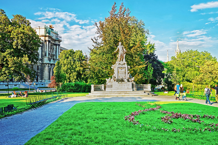 Vienna, Austria - August 31, 2013: Mozart statue in Burggarten Park, Vienna, Austria. People on the background
