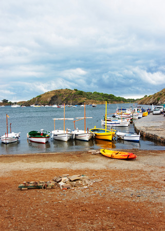 Boats in the shore of Port Lligat village of Cadaques located in a bay of Mediterranean Sea, Catalonia, Spain.