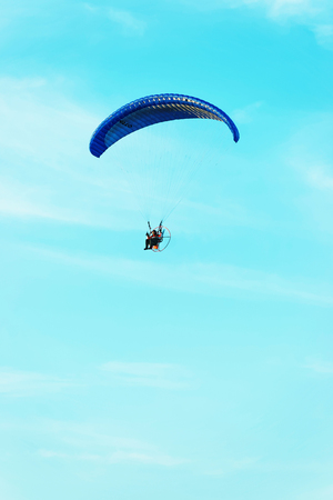 Paraglider flying over with the parachute in Poland