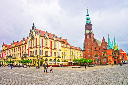Wroclaw, Poland - May 3, 2014: People at Old and New Town Halls on the Market Square of Wroclaw, Poland. Editorial