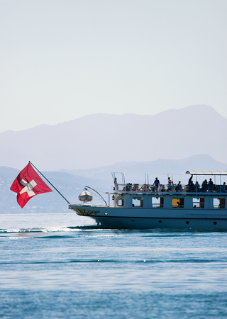 Ferry cruise at Lake Geneva in Lausanne, Switzerland. People on the background Stock Photo