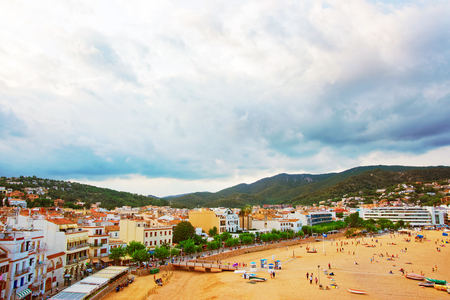 Tossa de Mar, Spain - August 4, 2010: Beach and people at Tossa de Mar on the Costa Brava at the Mediterranean Sea in Spain.