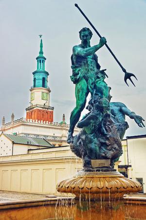 wielkopolska: Poznan, Poland - May 7, 2014: Neptune fountain in Old Market Square in the city center, Poznan, Poland.