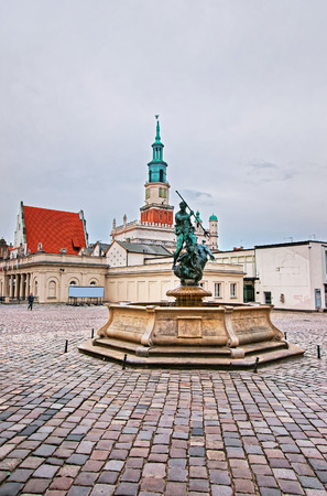 Poznan, Poland - May 6, 2014: Neptune fountain on Old Market Square in the city center, Poznan, Poland. People on the background Editorial