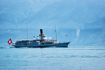 Lausanne, Switzerland - August 26, 2016: Ferry on Geneva Lake in Lausanne, Switzerland. People on the background Stock Photo