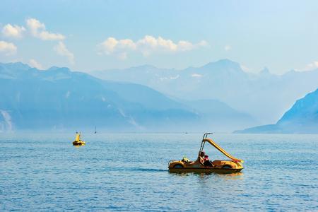 Lausanne, Switzerland - August 26, 2016: People in catamarans on Geneva Lake in Lausanne, Switzerland