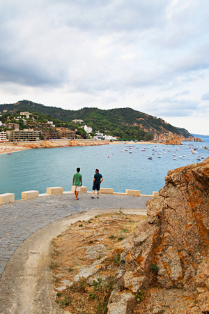 People in the fort of Tossa de Mar on the Costa Brava at the Mediterranean Sea in Spain.