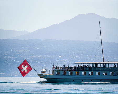 Ferry cruise in Lake Geneva in Lausanne, Switzerland. People on the background