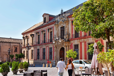 Archbishop Palace in Seville, Andalusia, Spain. People on the background