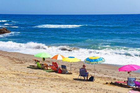 beachfront: People sunbathing on the beach at the Mediterranean Sea in Marbella, Andalusia, Spain