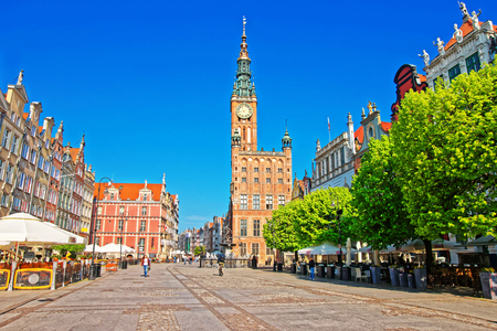 Main City Hall and Dlugi Targ Square in the old city center of Gdansk, Poland. People on the background.